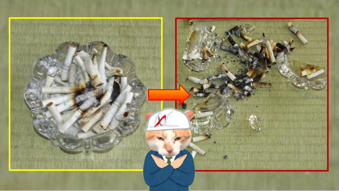 吸い殻が溜まった状態のガラス製灰皿にたばこを入れる